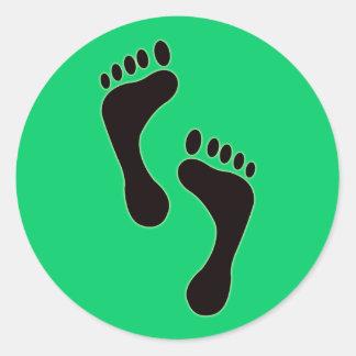 De Sticker van voetafdrukken