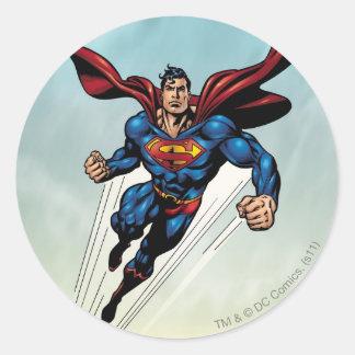 De superman springt omhoog ronde sticker