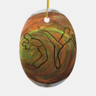 de vechtsportenmuziek van de ornamentdans keramisch ovaal ornament