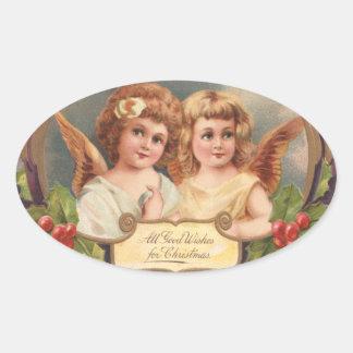 De vintage Engelen van Kerstmis Ovale Sticker