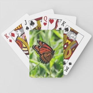 De vlinder van de monarch tijdens de vlucht speelkaarten