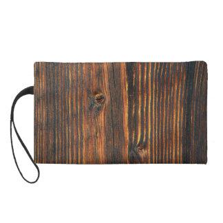 Donkeroranje houten muurtextuur tasje met polsbandje
