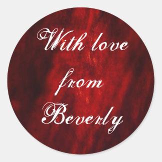 Donkerrood met de sticker van de Liefde…