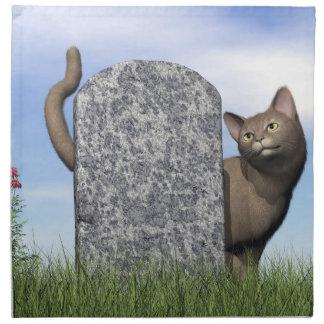 Droevige kat dichtbij grafsteen servet