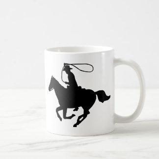 Een cowboy die met lasso. berijden koffiemok
