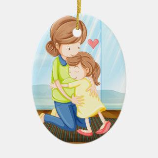 Een kind die haar moeder koesteren keramisch ovaal ornament