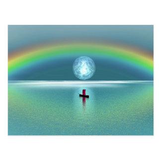 Een kleine boot in de oceaan met maan en regenboog briefkaart