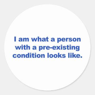 Een persoon met een reeds bestaande voorwaarde ronde sticker