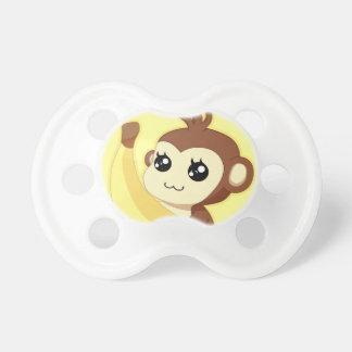 Een zeer leuke en kawaiiaap die een banaan houden baby speentje