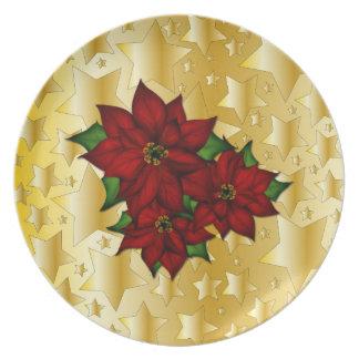 Feestelijk gouden sterontwerp met poinsettia party bord