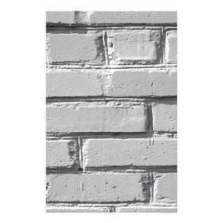 Fragment van grijze bakstenen muurclose-up aangepast briefpapier