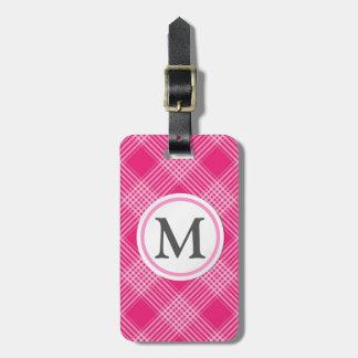 Gecontroleerd roze bagagelabel