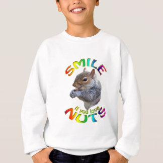 glimlach als u noten van regenboog houdt trui