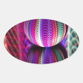 Golven in kristallen bol ovale sticker