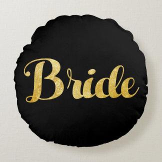 Gouden bruid rond kussen