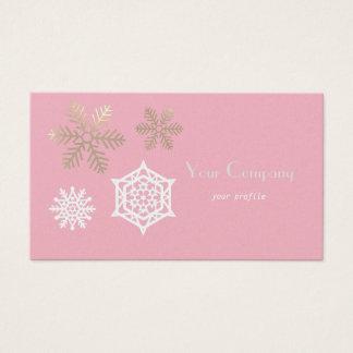 gouden en witte sneeuwvlokken tegen bord - roze visitekaartjes