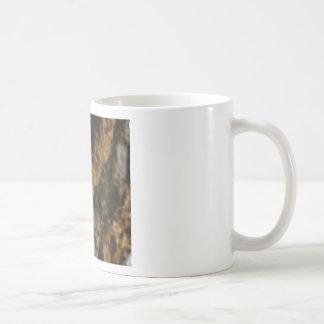 gouden en zwarte steen koffiemok