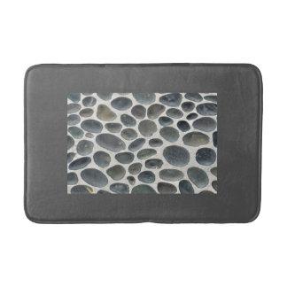 Grijze badmat met kiezelsteen gevormd bijvoegsel