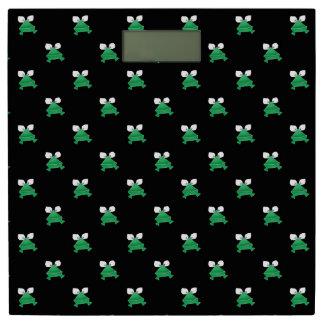 Groene Kikkers op de Zwarte Schaal van het Gewicht Personenweegschaal