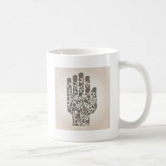 Hand van een deel van een lichaam koffiemok