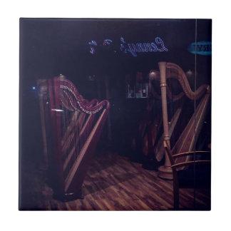 Harpen in schaduw tegeltje