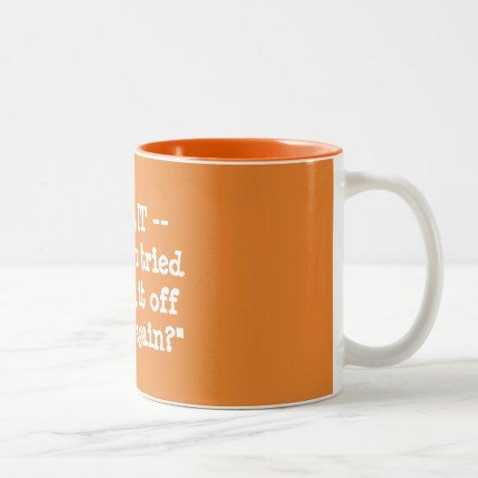 Hebt u geprobeerd uitzettend het en op opnieuw? tweekleurige koffiemok