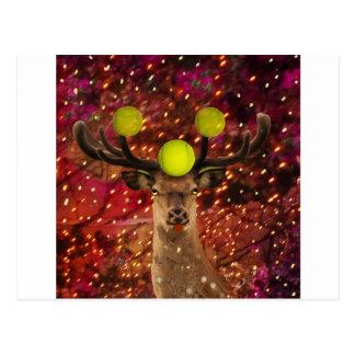 Herten met tennisballen in een glanzend bos. briefkaart