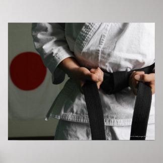Het Aanhalen van de Vechter van Taekwondo Riem Poster