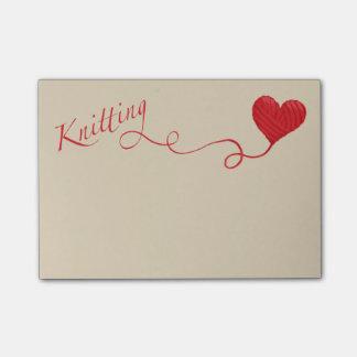 Het breien met het Garen van het Hart in Rood Post-it® Notes