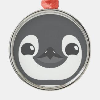 het gezicht van de babypinguïn zilverkleurig rond ornament