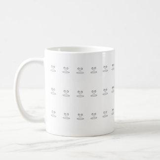 Het gezicht van de cartoon koffiemok