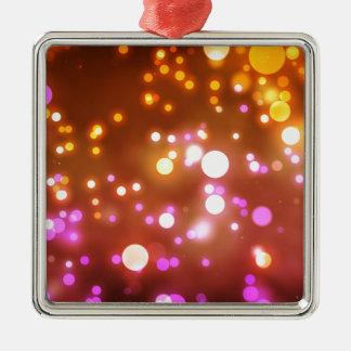 Het gloeien lichten zilverkleurig vierkant ornament