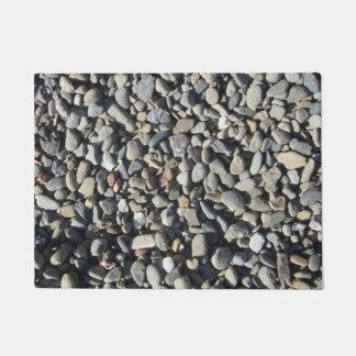 Het grint van het basalt deurmat