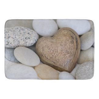 Het hart van de steen badmat
