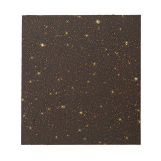 Het heelal met Gouden en Bruine Sterren Notitieblok