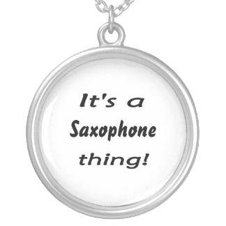 Het is een saxofoonding! zilver vergulden ketting