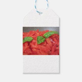 Het koken van eigengemaakte tomatensaus die verse cadeaulabel