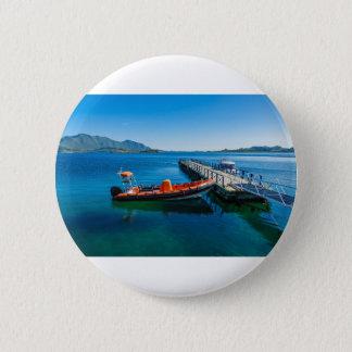 Het landen mannetje en snelheidsboot ronde button 5,7 cm