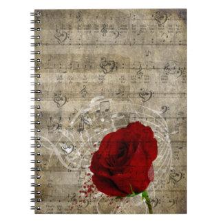 Het mooie rood nam de langzaam verdwenen piano van notitieboeken