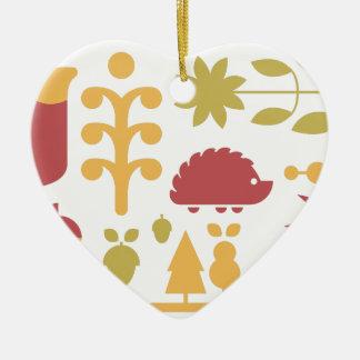 Het naadloze patroon van de herfst met leuke keramisch hart ornament