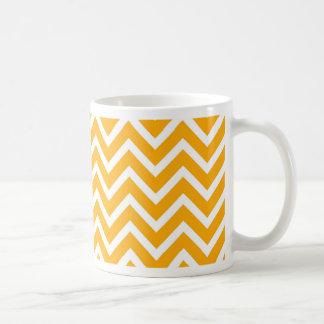 het oranje witte ontwerp van het zigzagpatroon koffiemok