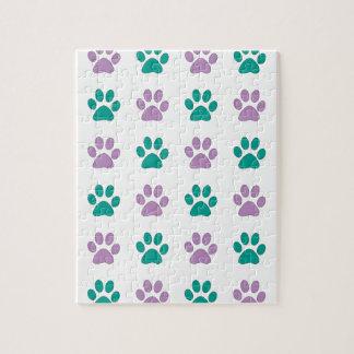 Het paarse en blauwgroen print van de puppypoot legpuzzel