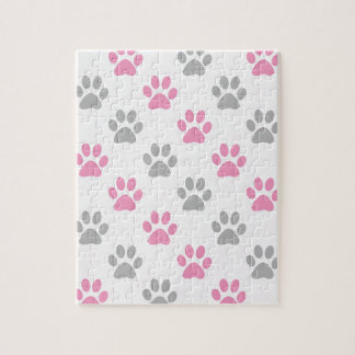 Het roze en grijze patroon van puppypoten puzzel