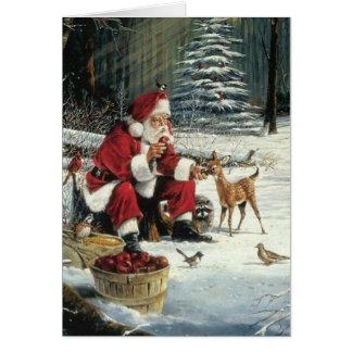 Het schilderen van de Kerstman - Kerstmisart. Kaart