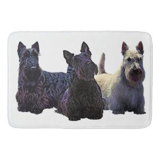 Het Schotse zwarte/wheaten trio van Terrier, Badmat