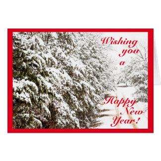 Het sneeuw Gelukkige Wenskaart van het Nieuwjaar