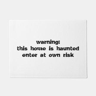 het spookhuis van de deurmat