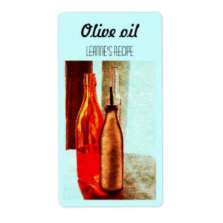 Het stillevenetiket van olijfolieflessen etiket