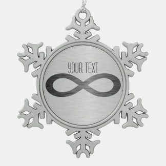 Het Symbool van de oneindigheid op de Textuur van Tin Sneeuwvlok Ornament