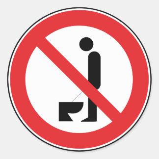 Het urineren terwijl de status Sticker wordt verbo